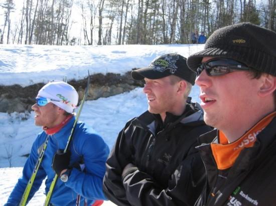 sim, chambo, and brandon attentively watching the biathlon race